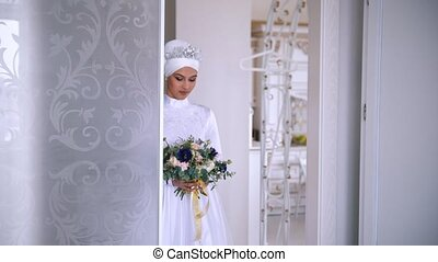 Beautiful muslim bride with make up in beautiful wedding dress
