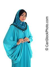 Beautiful Muslim fashion girl isolated on white