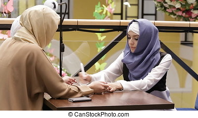 Beautiful Muslim Girl In Cafe