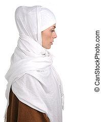 Beautiful Muslim woman isolated on white, profile