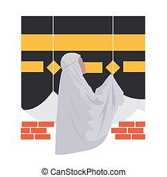 Beautiful muslim woman praying at Kaaba, Mecca, Saudi Arabia