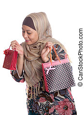 Beautiful Muslim woman with brightly colored shopping bags