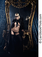 beautiful mysterious woman with venetian mask in lingerie