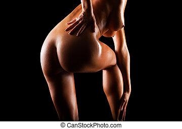 beautiful naked body isolated on black background