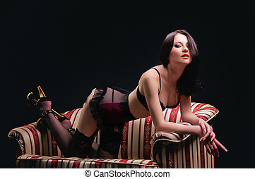 beautiful naked brunette on the couch