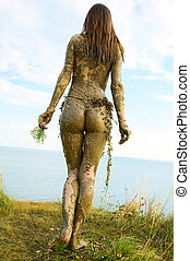 Beautiful naked girl in a loincloth totally wild