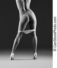 beautiful naked womans body on grey background