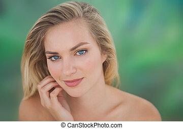 Beautiful natural blonde looking at camera