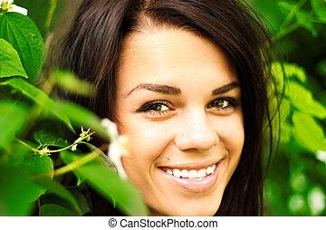 Beautiful natural girl smiling outdoors