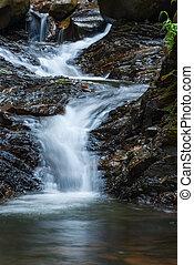 beautiful natural stream among stones.