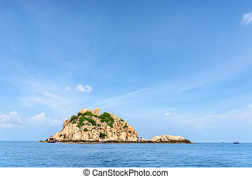 Beautiful nature landscape of Shark Island Divesite small rock island at Ko Tao under the blue sky on the sea in summer is a famous tourist attractions in the Gulf of Thailand, Surat Thani, Thailand