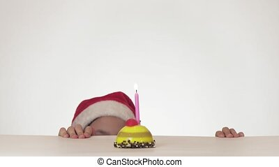 Beautiful naughty girl teenager in Santa Claus hat secretly...