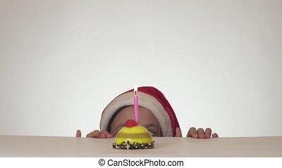 Beautiful naughty girl teenager in Santa Claus hat secretly...