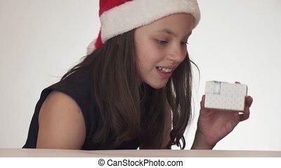 Beautiful naughty teen girl in Santa Claus hat secretly...