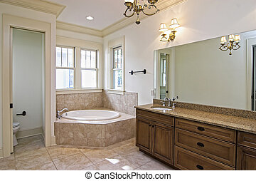 beautiful new bathroom with granite and tile