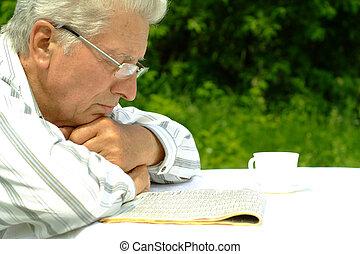 Beautiful nice elderly man in nature
