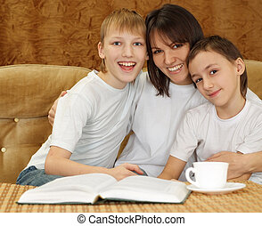Beautiful nice mom and sons sitting