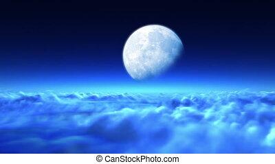 Beautiful night flight over clouds