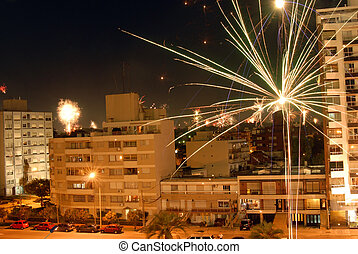 Beautiful night scene fireworks celebration of new year 2010 with fireworks over the buildings. Montevideo, Uruguay