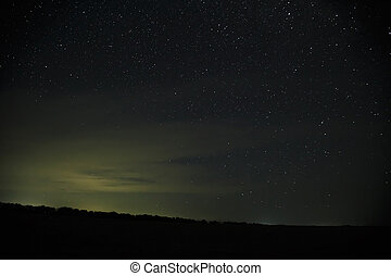 Beautiful night sky with stars. Milky Way over field