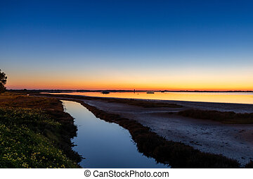 nightfall with a colorful sky over wetlands and canals nature landscape