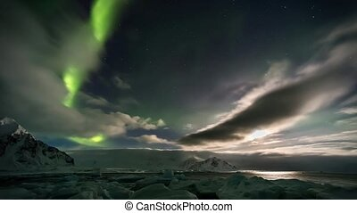 Beautiful Northern Lights over the Arctic mountains and...