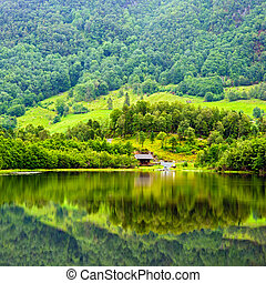 Beautiful Norwegian landscape with water reflection