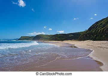 Beautiful ocean coastline with Garie beach and green hills....