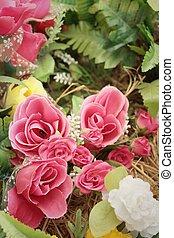 beautiful of rose artificial flowers in garden