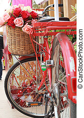beautiful of rose artificial flowers in vintage bicycle