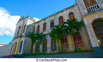 Beautiful old building surrounded by palm trees