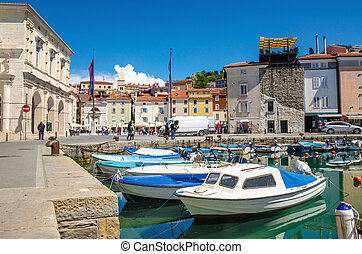 Beautiful old buildings and boats in the Harbor, Piran, Slovenia