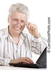 Beautiful old Caucasian man with laptop sits