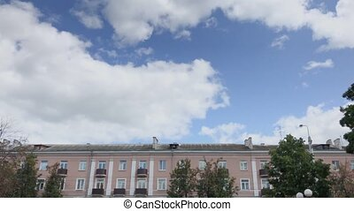 Beautiful old house on a background of blue sky.