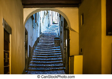 Beautiful old narrow stairs and arch on Italy street