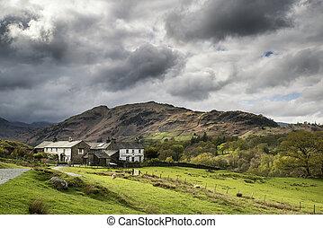 Beautiful old village landscape nestled in hills in Lake District
