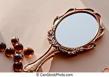 hand holding antique mirror. Perfect Mirror Beautiful Old Vintage Mirror Is On The Table On Hand Holding Antique Mirror C
