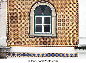 beautiful old window on tiled wall in Portugal