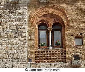 beautiful old window with arc and column