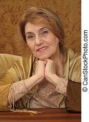 beautiful old woman sitting on a sofa