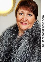 older woman in a fur cape