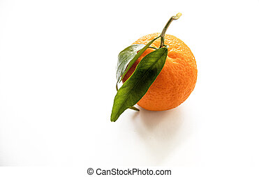 orange mandarin on a white background isolated with green leaves