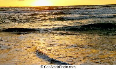 Beautiful orange sunset on sea. Summer outdoor. Used tripod....