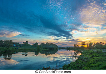 Beautiful orange sunset on the river Uvod 16.05.2018 in...