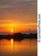Beautiful orange sunset on the river Volga