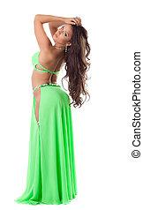 Beautiful oriental dancer in green suit