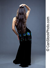 Beautiful oriental dancer with long hair