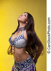 Beautiful oriental dancer with long hair