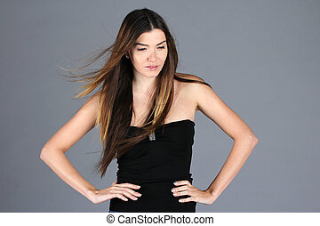 Beautiful oriental woman posing on grey background
