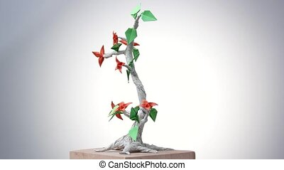 Beautiful origami bonsai. Decorative paper tree with leaves...